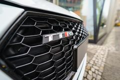 Emblem of the compact sports coupe Audi TT RS. BERLIN - DECEMBER 21, 2017: Showroom. Emblem of the compact sports coupe Audi TT RS. Since 2016 Stock Photography