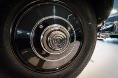 Locking hubs of the luxury car Rolls-Royce Phantom III Touring Limousine, 1937. BERLIN - DECEMBER 21, 2017: Showroom. Locking hubs of the luxury car Rolls-Royce Stock Image