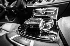 The shift knob of the executive car Mercedes-Benz E-Class E220d W213. BERLIN - DECEMBER 21, 2017: Showroom. The shift knob of the executive car Mercedes-Benz E royalty free stock photos