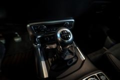The shift knob of mid-size luxury pickup truck Mercedes-Benz X-Class X220d 4Matic. BERLIN - DECEMBER 21, 2017: Showroom. The shift knob of mid-size luxury stock photography