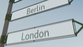 Berlin direction sign on road signpost with European cities captions. 4K conceptual clip. Berlin direction sign on road signpost with European cities captions stock video footage
