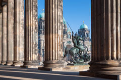 Berlin - The Dom, columns of Altes Museum and the bronze sculpture Lowenkampfer by Albert Wolff and designed by Christian Daniel. 1861 royalty free stock photos