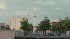 Berlin establishing shot TV Tower And Swiss Embassy. Berlin, Establishing Shot TV Tower With Switzerland Embassy And Flag Waving. Summer City Landscape With stock video