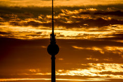 Berlin fernsehturm/ TV tower. Beautiful Berlin skyline with focus on the magnificent Fernsehrturm / TV Tower against a backdrop of orange dawn sky Royalty Free Stock Photos