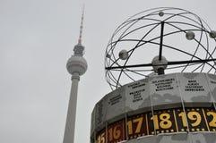 Berlin Fernsehturm. Berlin Alexanderplatz worldtime clock urania and Berlin TV-Tower Stock Photos
