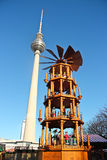 Berlin fernsehturm and wood christmas carrousel Stock Photo