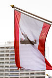 A berlin flag with plattenbau building in the background Stock Image
