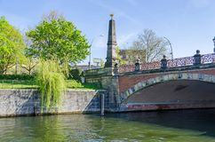 Banks of the river Spree and the Luther Bridge in Berlin. Berlin, Germany - April 22, 2018: Banks of the river Spree and the Luther Bridge German: Lutherbruecke Stock Photos