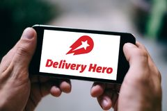 BERLIN, GERMANY - APRIL 18, 2018: Closeup of iPhone screen with DELIVERSY HERO APP LOGO and ICON. Delivery Hero is a popular food delivery platform that uses Stock Photos