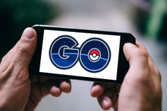 BERLIN, GERMANY - APRIL 20, 2018: Closeup of iPhone screen with POKEMON GO APP LOGO and ICON stock photos