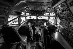 Cockpit of Boeing E-3A Sentry AWACS. BERLIN, GERMANY - APRIL 25, 2018: Cockpit of Boeing E-3A Sentry AWACS. Black and white. Exhibition ILA Berlin Air Show 2018 Royalty Free Stock Photos