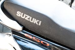 Suzuki logo. Berlin, Germany - April 18, 2019: Emblem of Suzuki SV650, a street motorcycle manufactured for the international market by the Suzuki Motor royalty free stock images