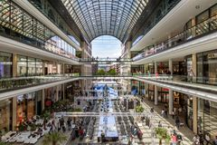 New Berlin shopping mall. BERLIN, GERMANY - APRIL 28, 2018: Interior view of the new Mall of Berlin shopping centre at Leipziger Platz. The mall has various Stock Images