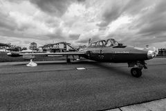 Jet trainer Fouga CM.170 Magister on the airfield. BERLIN, GERMANY - APRIL 25, 2018: Jet trainer Fouga CM.170 Magister on the airfield. Black and white Royalty Free Stock Images