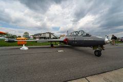 Jet trainer Fouga CM.170 Magister on the airfield. BERLIN, GERMANY - APRIL 25, 2018: Jet trainer Fouga CM.170 Magister on the airfield. Exhibition ILA Berlin Air Stock Photos