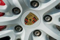 Porsche car emblem. Berlin, Germany - April 18, 2018: Porsche emblem on a car wheel. Porsche AG is a German automobile manufacturer specializing in high royalty free stock photo