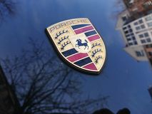 Porsche emblem. Berlin, Germany - April 15, 2018: Porsche sign on a black car. Porsche AG is a German automobile manufacturer specializing in high-performance royalty free stock photos