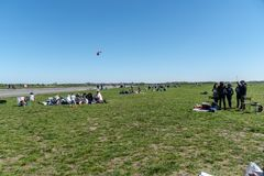 Tempelhof Park in Berlin, Germany. Berlin, Germany - April 22, 2019: Relaxation on the grass in Tempelhof Field, former airport now a public green area, the stock images