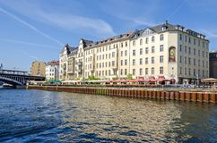 River Spree with its bank Schiffbauerdamm, the famous cult tavern 'Staendige Vertretung' and other popular restaurants. Berlin, Germany - April 22, 2018: River stock photography