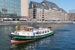 Small tour boat on River Spree. Berlin Germany - April 20. 2018: Small tour boat on River Spree royalty free stock photos