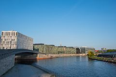 Spree river in Berlin with modern architecture and people enjoying the sun. Berlin Germany - April 20. 2018: Spree river in Berlin with modern architecture and Royalty Free Stock Photo