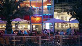 BERLIN, GERMANY - APRIL 30, 2018. Street cafe and restaurant in the evening. BERLIN, GERMANY - APRIL 30, 2018. Sony Center at the Potsdamer Platz Royalty Free Stock Image
