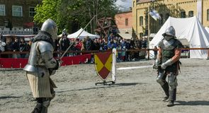 BERLIN, GERMANY - April 17, 2017: Two actors playing warriors fighting with swords on a medieval fair in germany stock images