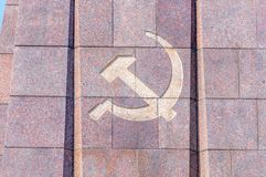 Close up for hammer and sickle at Soviet War Memorial at Treptow. Berlin, Germany - August 18, 2018: Close up for hammer and sickle at Soviet War Memorial at royalty free stock images
