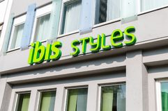 Green sign of ibis Styles hotel belong to Accor Hotels Group. Berlin, Germany - August 18, 2018: Green sign of ibis Styles hotel belong to Accor Hotels Group stock images
