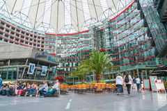 Sony Center, Potsdamer platz, Berlin. BERLIN, GERMANY - AUGUST 25, 2017; Interior food court  with people enjoying the plaza area of modern Sony Center at Stock Photo