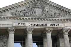 Berlin, Germany - August 18, 2017: Reichstag building is Parliam. Ent of Germany  in Berlin city. The big text DEM DEUTSCHEN VOLKE meaning To the German People Royalty Free Stock Photo