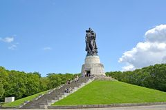 BERLIN, GERMANY. Soldier liberator`s sculpture in the summer afternoon. Treptov-park Royalty Free Stock Photography