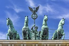 252/5000 Berlin, Germany, Brandenburger Tor, 15-8-2015 Portrait from a low point of view, of the 4 horses with their rider, who stock images