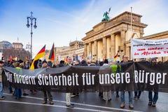 BERLIN, GERMANY - DEC 1, 2018: Anti-immigration demonstration, The Brandenburg Gate, Berlin, Germany. BERLIN, GERMANY - DEC 1, 2018: Anti-immigration royalty free stock images