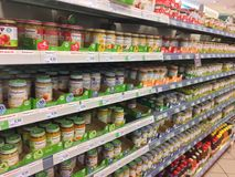 Baby food products on supermarket shelf. Berlin, Germany - December 2, 2017: Baby food products on supermarket shelf. Many brands are recognizable Royalty Free Stock Photo