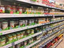 Baby food products on supermarket shelf Royalty Free Stock Photo