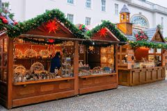 Berlin, Germany - December 13, 2017: Christmas Market in Opernpalais at Mitte in Winter Berlin, Germany. Advent Fair Decoration. And Stalls with Crafts Items stock photo