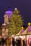 Decorated booths and christmas lights at Gendarmenmarkt Christmas Market. Berlin, Germany - December 6, 2017: Decorated booths and christmas lights at royalty free stock image