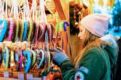 Berlin, Germany - December 9, 2017: Girl buying Gingerbread hearts cookies at Christmas Market at Charlottenburg Palace in Winter. Berlin, Germany. Advent Fair royalty free stock photo