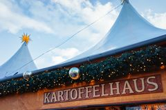 Berlin, Germany - December 8, 2017: Kartofelhaus Potato house Sign plate at Night Christmas Market near Gendarmenmarkt in Winter. Berlin, in Germany. Advent royalty free stock photography