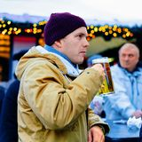 Berlin, Germany - December 8, 2017: Man drinking beer at Christmas Market stalls Winter Berlin at Christmas Market stalls at. Gendarmenmarkt in Winter Berlin stock images