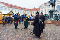 Berlin, Germany - December 9, 2017: Musical group playing at Christmas Market near Charlottenburg Palace at Winter Berlin, Germany. Advent Fair Decoration, and stock image