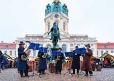 Berlin, Germany - December 9, 2017: Musical group playing at Christmas Market near Charlottenburg Palace at Winter Berlin, Germany. Advent Fair Decoration, and royalty free stock photography