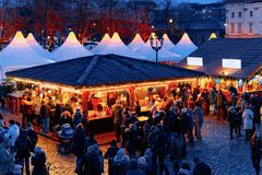 Berlin, Germany - December 9, 2017: Night Christmas Market near Charlottenburg Palace, in Winter Berlin, Germany. Advent Fair. Decoration and the Stalls with royalty free stock image