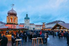 Berlin, Germany - December 9, 2017: Night Christmas Market near Charlottenburg Palace at Winter Berlin, Germany. Advent Fair. Decoration and the Stalls with stock photos