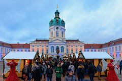 Berlin, Germany - December 9, 2017: Night Christmas Market near Charlottenburg Palace at Winter Berlin, Germany. Advent Fair. Decoration, and the Stalls with stock photos