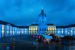 Berlin, Germany - December 9, 2017: Night Christmas Market near Charlottenburg Palace at Winter Berlin, Germany. Advent Fair. Decoration, and the Stalls with royalty free stock photography