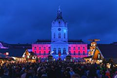 Berlin, Germany - December 9, 2017: Night Christmas Market near Charlottenburg Palace, Winter Berlin, Germany. Advent Fair. Decoration, and the Stalls with stock photography