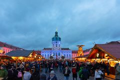 Berlin, Germany - December 9, 2017: Night Christmas Market near Charlottenburg Palace at Winter Berlin, Germany. The Advent Fair. Decoration and the Stalls with royalty free stock photography