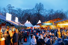 Berlin, Germany - December 9, 2017: Night Christmas Market near Charlottenburg Palace, at Winter Berlin, Germany. Advent Fair. Decoration and the Stalls with stock image